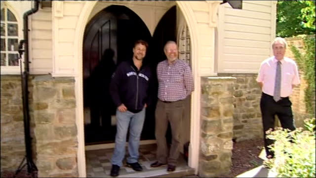 russell crowe visits durham university england durham ext russell crowe and bill bryson out of chapel building then various of crowe and bryson... - russell crowe stock videos & royalty-free footage