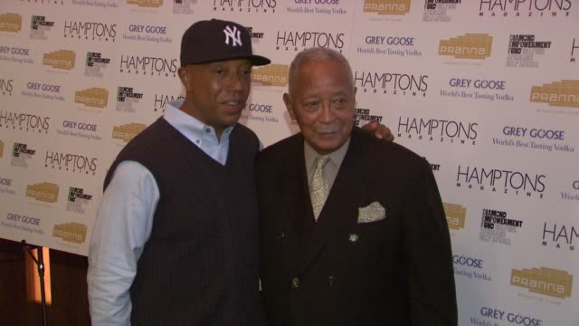 russell simmons and david dinkins at the serena williams hosts hamptons magazine cover party with grey goose at new york ny. - グレイグース点の映像素材/bロール