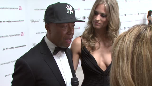 Russell Simmons and guest at the 17th Annual Elton John AIDS Foundation Academy Award Viewing party at Los Angeles CA