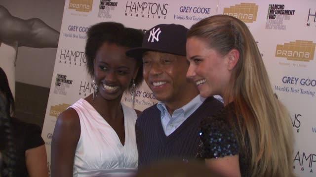 russell simmons and guests at the serena williams hosts hamptons magazine cover party with grey goose at new york ny. - グレイグース点の映像素材/bロール