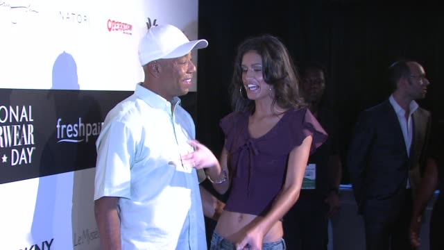 Russell Simmons and Jaslene Gonzalez at the Lydia Hearst Hosts National Underwear Day at New York NY