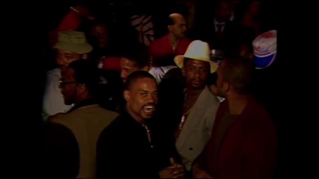 stockvideo's en b-roll-footage met russell simmons and lovebug starski in the crowd at the disco fever night club ii aka the devils nest in the bronx ny - hiphop