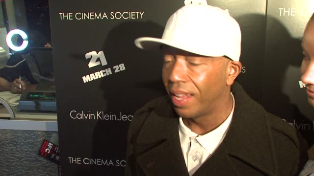 "russell simmons and porschla coleman on what brings them out tonight, if they are big gamblers and her new magazine spread at the premiere of ""21"" at... - russell simmons stock videos & royalty-free footage"
