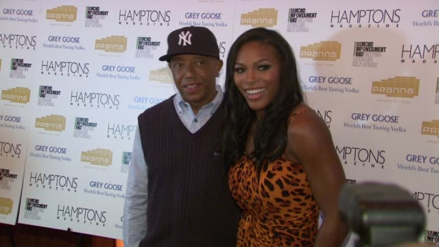 russell simmons and serena williams at the serena williams hosts hamptons magazine cover party with grey goose at new york ny. - グレイグース点の映像素材/bロール