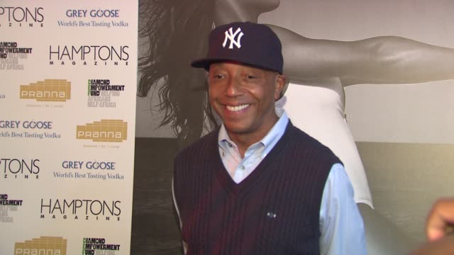 russell simmons at the serena williams hosts hamptons magazine cover party with grey goose at new york ny. - グレイグース点の映像素材/bロール