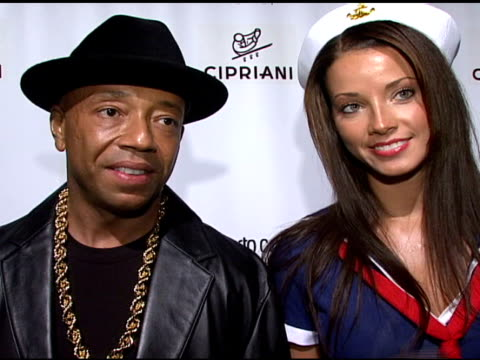 Russell Simmons on what brings him out tonight his expectations for the evening borrowing his costume from his brother and looking forward to Eve's...