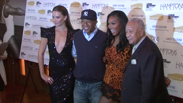 russell simmons , serena williams, david dinkins at the serena williams hosts hamptons magazine cover party with grey goose at new york ny. - グレイグース点の映像素材/bロール