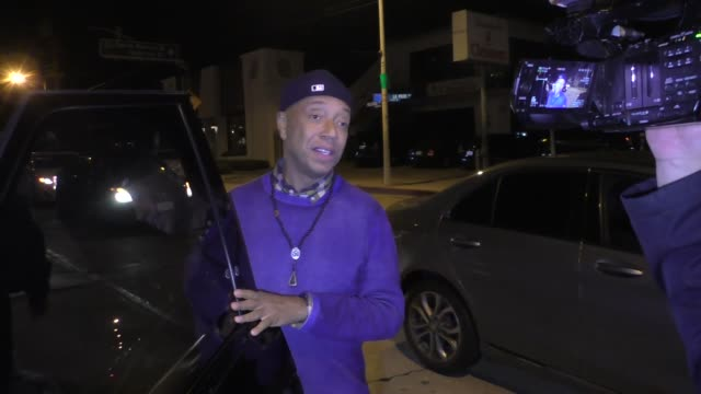 interview russell simmons with a new mystery woman on his sex abuse charges outside craig's in west hollywood at celebrity sightings in los angeles... - russell simmons stock videos & royalty-free footage