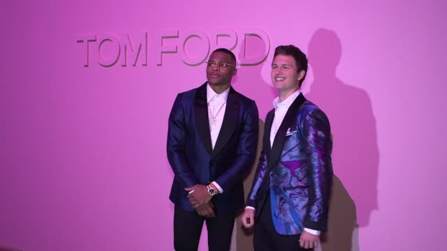 russell westbrook and ansel elgort at tom ford - new york fashion week - spring 2018 at park avenue armory on september 06, 2017 in new york city. - 武器庫点の映像素材/bロール