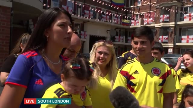 Buildup to England v Colombia match LIVE ENGLAND London Bermondsey Kirby Estate EXT Reporter to camera CUTAWAY to flats on estate hung with England...