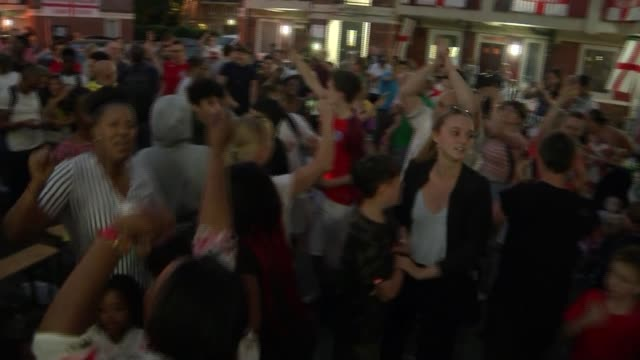 England beat Colombia fan reaction in England ENGLAND London Bermondsey Various of England fans including children singing and dancing to 'Three...