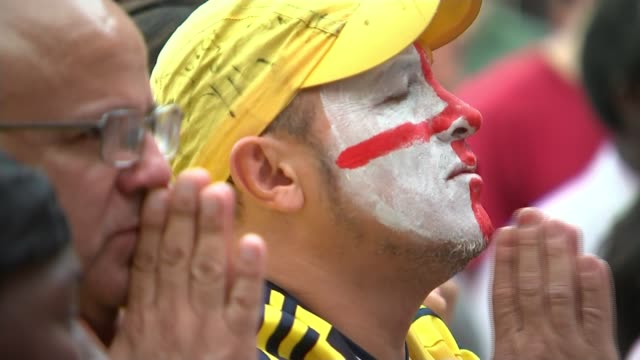 England beat Colombia fan reaction in England ENGLAND London Bermondsey EXT Colombia football fan stands making prayer gesture Colombia fans...