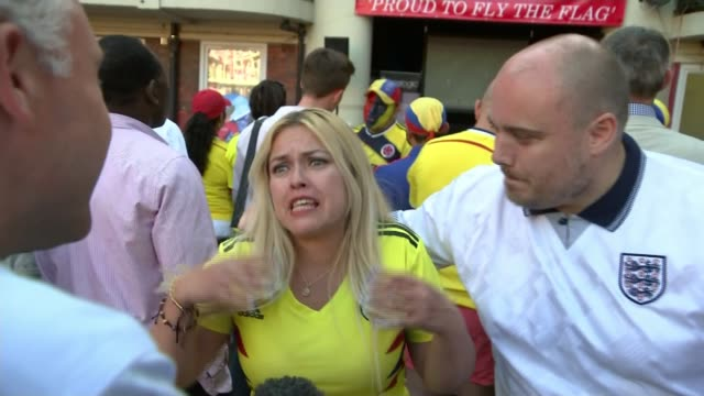 England beat Colombia fan reaction in England ENGLAND London Bermondsey EXT Various of Colombia football fans dancing as gathering to watch England v...