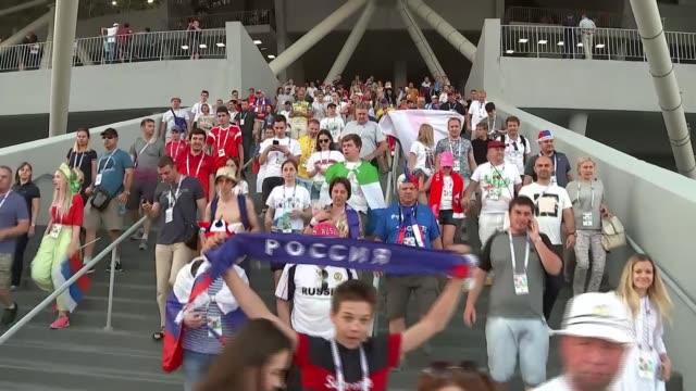stockvideo's en b-roll-footage met england beat sweden to reach semifinals russia samara samara arena ext fans leaving stadium after england v sweden match vox pops - halve finale