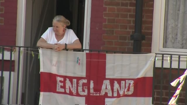 England players and fans prepare for quarter final against Sweden ENGLAND London Bermondsey Kirby Estate EXT Various shots of flats on estate hung...