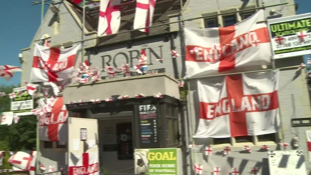 stockvideo's en b-roll-footage met england prepare for quarter final against sweden england county durham south shields ext gvs the robin pub decorated with england flags - wereldkampioenschap sport
