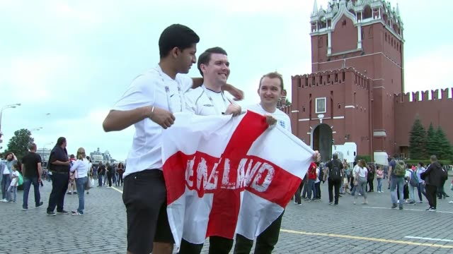 england prepares for semifinal against croatia russia moscow ext england fans towards fans with england flag outside luzhniki stadium england fans... - luzhniki stadium stock videos & royalty-free footage