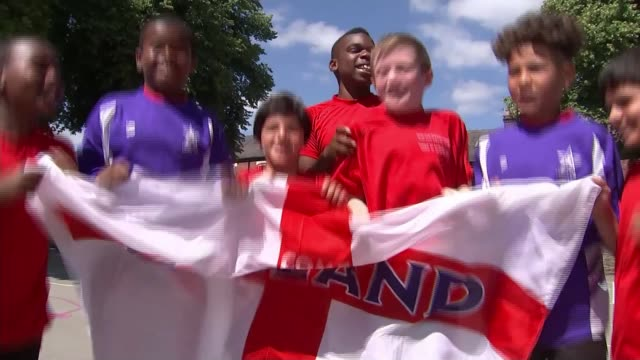 England team and fans prepare for semifinal against Croatia ENGLAND Yorkshire Sheffield Porter Croft Infants School EXT Various of schoolchildren...
