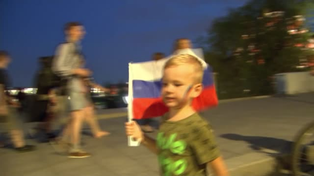 russia 2018 world cup finals: celebrations as russia reach quarter finals; russia, moscow; russian fans celebrating russia beating spain to reach the... - torschuss stock-videos und b-roll-filmmaterial