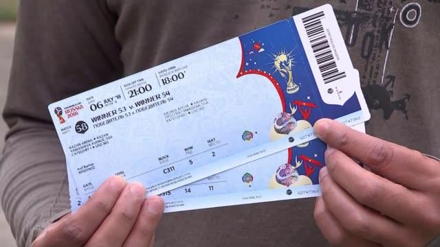 vídeos de stock, filmes e b-roll de england fans warned of risks of travelling england ext asif burhan holding up tickets for russian 2018 world cup finals match russian 2018 world cup... - ticket