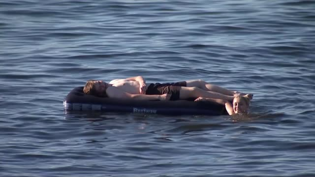 france and belgium reach semifinal as england prepare for game against sweden russia samara ext man lying on lilo in the river volga - soccer competition stock videos & royalty-free footage