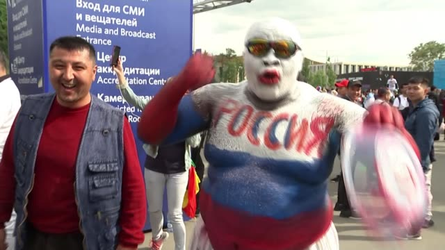 opening day russia moscow ext close shot stomach of russian man painted with russian flag colours pull brass band playing sot football fans along... - fifa world cup stock videos & royalty-free footage