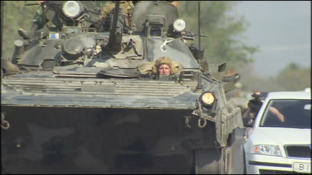 vídeos y material grabado en eventos de stock de russia deploy troops in the disputed region of ossetia. shows exterior shots russian troops driving in large convoy of t-62 tanks. on august 20, 2008... - georgia