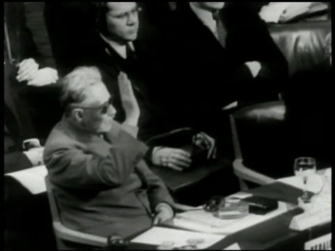 russia diplomat andrei vyshinsky raising hand at seat other member w/ raised hand ws vyshinsky leaving table ext ws vyshinsky exiting building into... - 1948 stock-videos und b-roll-filmmaterial