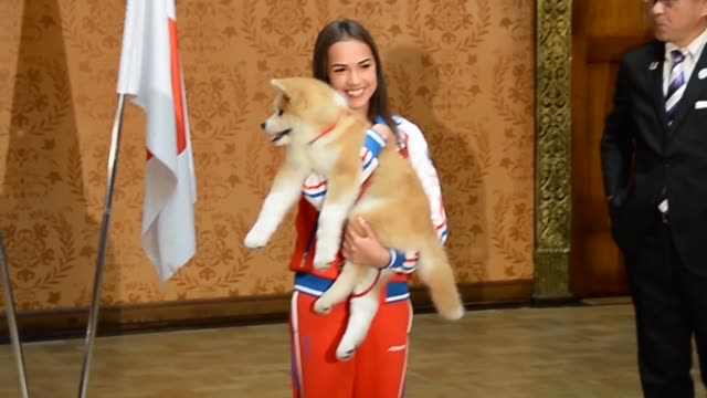 Russian Olympic figure skating champion Alina Zagitova received an Akita puppy Saturday from a group preserving the Japanese dog breed at a ceremony...