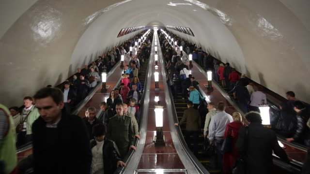 russia, moscow, escalator leading into the world's deepest  metro system - escalator stock videos & royalty-free footage