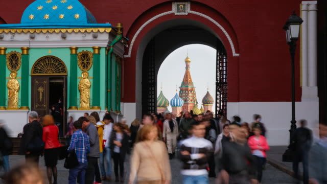 russia, moscow, st basil's cathedral visible through the iberian chapel and resurrection gate leading into red square - time lapse - resurrection religion stock videos & royalty-free footage