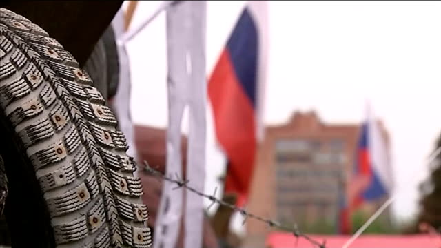 russia welcomes results of two independence referendums in eastern ukraine; donetsk: russian flag flying above barricade tilt down tyres rusian flags... - barricade stock videos & royalty-free footage