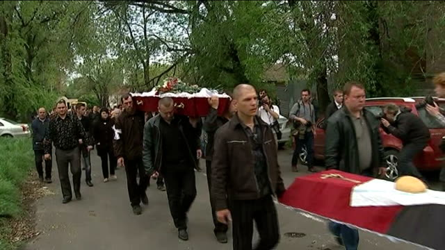 russia welcomes results of two independence referendums in eastern ukraine ukraine donetsk ext funeral procession for those killed in the violence of... - mourner stock videos and b-roll footage