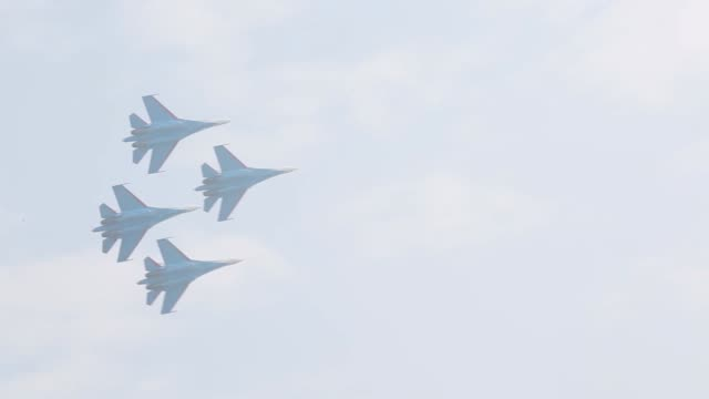 Russian Air Force Knights SU27 jets manufactured by Sukhoi Co fly in formation during an aerobatics display at the China International Aviation...