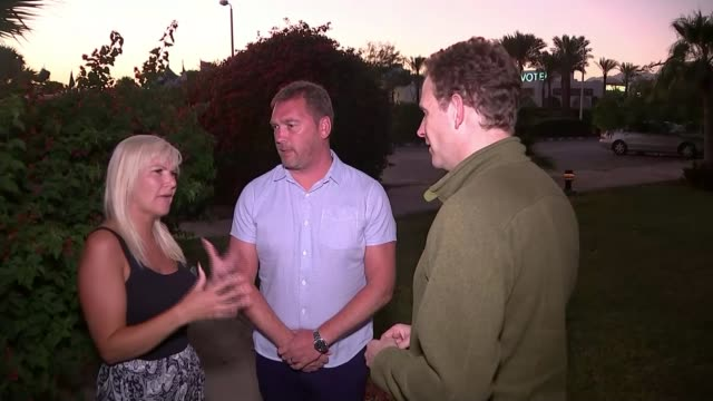 british tourists stranded over bomb fears brendan de garis and abigail de garis interview sot sharm elsheikh international airport departure terminal... - kogalymavia flug 9268 stock-videos und b-roll-filmmaterial