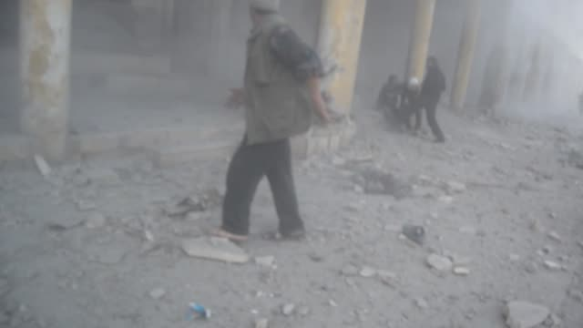 russian airstrikes hit a marketplace in ariha district of idlib syria on february 24 2016 at least 8 people were killed as dozens of wounded after... - mass murder stock videos & royalty-free footage