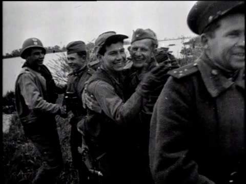 russian and american soldiers meet at the elbe river, hugging and kissing / soldiers shaking hands / russian and american soldiers meet / elbe river,... - russian ethnicity stock videos & royalty-free footage