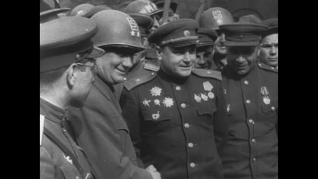 russian and american troops meet and greet at the elbe river - 1945 stock-videos und b-roll-filmmaterial