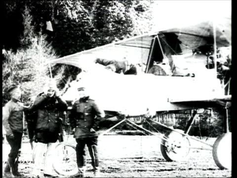 1915 montage b/w ws russian army aviators standing next to military biplane/ russia - prima guerra mondiale video stock e b–roll