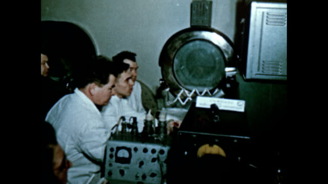russian astronauts alexi leonov and pavel belyayev in the voskhod 2 simulator - 1965 stock videos & royalty-free footage