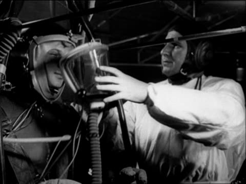a russian cosmonaut has an oxygen mask placed over his face prior to training in centrifuge machine - oxygen mask stock videos & royalty-free footage