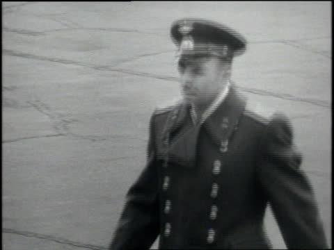 Russian cosmonaut Yuri Gagarin salutes Soviet Premier Nikita Khrushchev