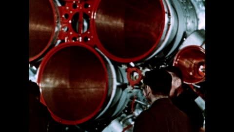 russian cosmonauts train for vostok 1 as the craft is prepared - tidigare sovjetunionen bildbanksvideor och videomaterial från bakom kulisserna
