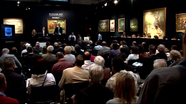 russian diplomats expelled from britain london sotheby's int various shots of auction of russian art underway in sotheby's auction room - サザビーズ点の映像素材/bロール