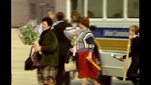 Russian diplomats expelled from Britain September 1985 Gatwick Airport EXT Expelled Russian diplomats and their families some holding bouquets...