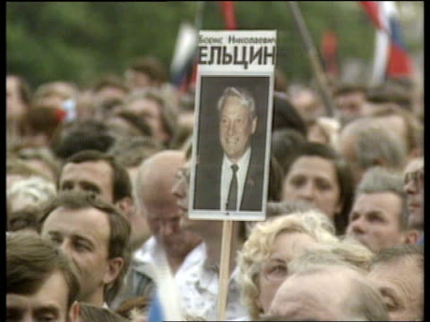 boris yeltsin; ussr moscow red square gv mass rally of yeltsin supporters standing outside the kremlin waving russian flags yeltsin poster held pull... - boris yeltsin stock videos & royalty-free footage