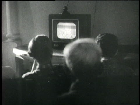 A Russian family watches Soviet Premier Nikita Khrushchev on television