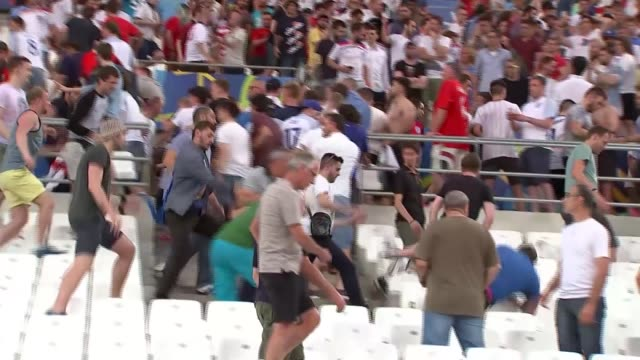 Russian fans attack English fans at the end of the match FRANCE Marseille Stade Velodrome EXT Various of Russian football supporters charging at and...
