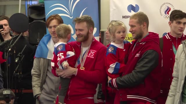 russian fans on monday gave gold medal winning athletes a heroes welcome home at a moscow airport following games overshadowed by the country's... - moscow russia video stock e b–roll