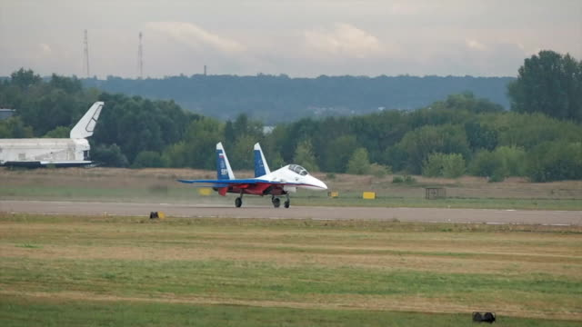 russian fighter plane su-27 landing - united states airforce stock videos and b-roll footage
